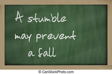 """"""" A stumble may prevent a fall """" written on a blackboard -..."""