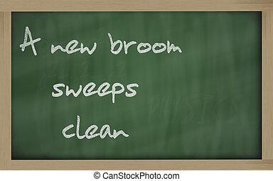 """"""" A new broom sweeps clean """" written on a blackboard"""