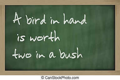 """"""" A bird in hand is worth two in a bush """" written on a..."""
