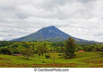 Volcano Arenal, Costa Rica - Volcano Arenal on a cloudy day,...