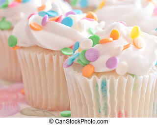 Cupcakes Frosted and Sprinkles - Fluffy white vanilla...