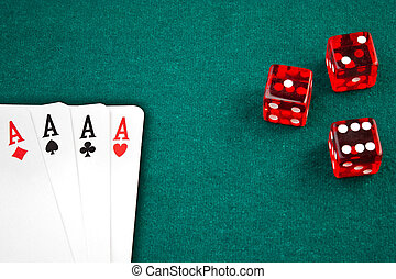 poker cards and dice on green