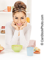 lovely housewife with cup of muesli - bright picture of...