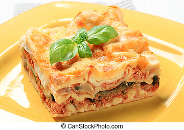 Lasagna - Portion of lasagna on a yellow plate