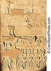 Part of a wall with hieroglyphs in Luxor temple, Egypt -...