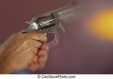 Firing a .357 Magnum - Closeup of hands holding and firing a...