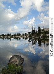 Sierra Nevada Lake Reflection - Morning reflection of sky,...