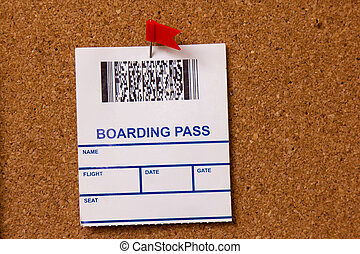 pinned boarding pass on cork background