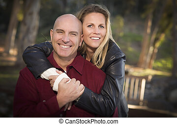 Attractive Couple Portrait in the Park - Attractive Hugging...