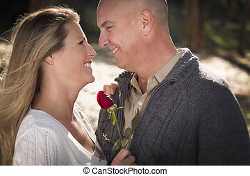 Attractive Young Couple with Rose