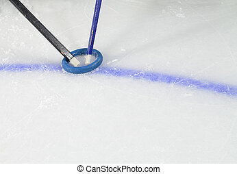 Ringette Sticks and Ring on Ice - Ringette Sticks fight for...