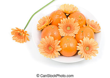 Orange and flower - Orange on the plate with african daisy...
