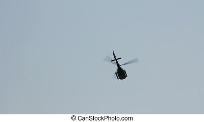Light helicopter - Helicopter flies away