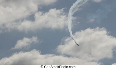 Aerobatic - Airplane flight in the sky on the aerobatic show