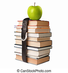 books pile with belt and apple - many books pile with apple...