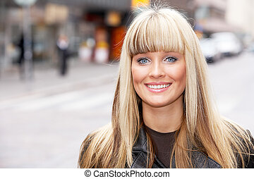 Young Woman Portrait - Young woman in street, looking at...
