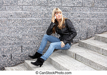 Young Woman On Mobile Phone - Young woman using mobile...