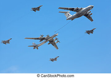 MOSCOW - MAY 9: Il-76 and Tu-95ms planes accompanied by...
