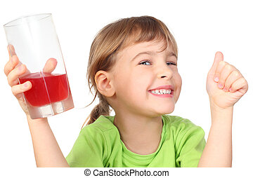 little girl in green shirt holding glass with juice and smiling, isolated on white, half body