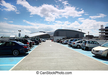 many cars are parked blue sky and white clouds very good...