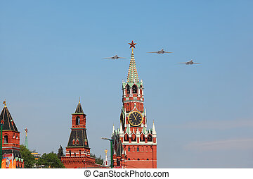 MOSCOW - MAY 9: Supersonic, variable-sweep wing heavy strategic Tu-160 airplanes fly over Red Square, Spasskaya Tower on victory parade on May 9, 2010 in Moscow, Russia
