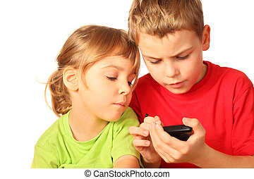 small girl and boy search for anything interesting in...