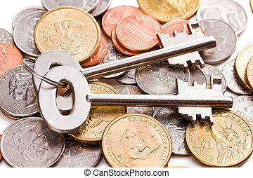 safe key with coins