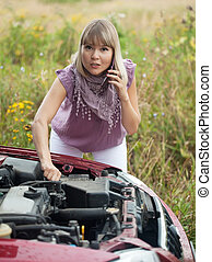 woman calling by mobile to auto support - Young woman...