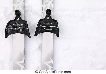 Pair of cross-country skis with simple binding on pure white...