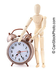 Wooden dummy with old-styled metal alarm clock.
