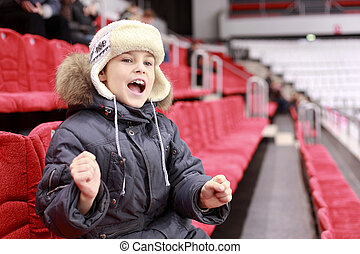 Boy loudly shouts on  hockey match