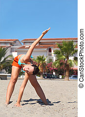 young beauty woman making gym exercises on beach, house and...