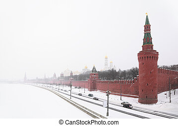View of the Kremlin Embankment and cathedrals in Moscow, Russia at wintertime during snowfall