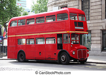 Empty red double-decker on street in London, England Summer