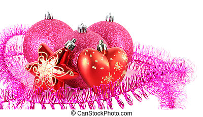 Three red Christmas tree balls behind star and heart surrounded by purple tinsel. Star, heart and front ball in focus.