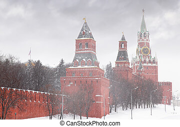 Kremlin chiming clock of the Spasskaya Tower in Moscow, Russia at wintertime during snowfall
