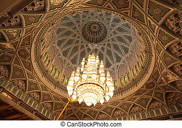 big beautiful lustre in a hall of Grand Mosque in Oman. the...