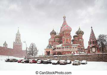 Car parking near Kremlin chiming clock of the Spasskaya...