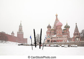 Cross-country skis and poles stuck in snow on Red Square...