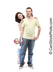 Young happy family -  mother, father and little daughter - are standing in embrace leaning on each other