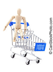 Wooden doll sitting in the metal shopping cart - Shopping...