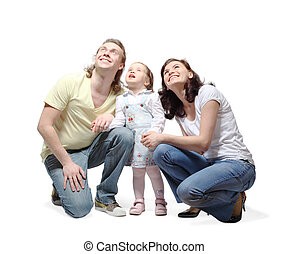 Mother, father and little daughter sit down, hold hands and...