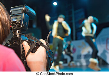 photographer shooting  dancers group on stage