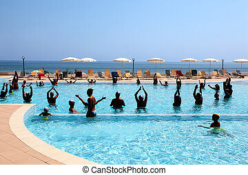 Many people in pool are engaged in sporting training in...
