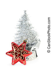 Red Christmas tree star and silver artificial Christmas tree...
