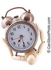 Wooden dummy crushed by old-styled metal alarm clock.