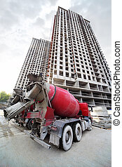 MOSCOW - SEPTEMBER 27: Concrete mixer stands near buildings...