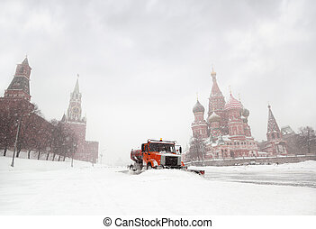 Snow-remover truck clean the road near Red Square, St Basil...