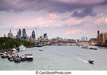 boats floating on river Thames. Westminster Bridge. clouds in sky