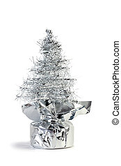 Silver artificial Christmas tree made of tinsel grows from...